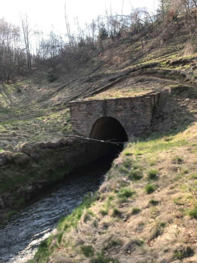 Münzbach stream tunnel entrance in dam wall of the Münzbachtalhalde